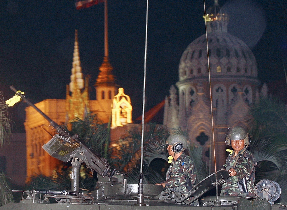 Thai soldiers stand guard on a military tank in front of the Government House in Bangkok after a coup in 2006. (Agence France-Press via Getty Images)
