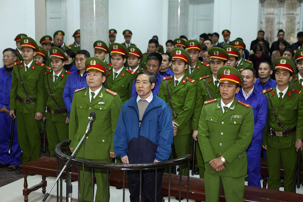Duong Chi Dung , 56, former chairman of Vinalines, and his accomplices listen to the verdict at a local People's Court in Hanoi on December 16, 2013. Vietnam, on December 16, sentenced two former top executives at scandal-hit national shipping company Vinalines to death for embezzlement as authorities try to allay rising public anger over corruption.  (Vietnam News Agency/AFP/Getty Images)
