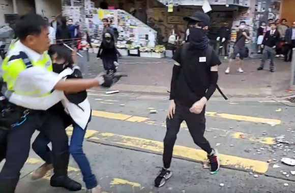 A video grab taken from Cupid News on Monday shows a policeman shooting a pro-democracy protester in the chest during a protest in Sai Wan Ho district. (Laurent Fievet/Cupid News/Afp Via Getty Images/The Washington Post)