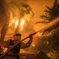 First fatality confirmed as raging wildfires spread across Southern California