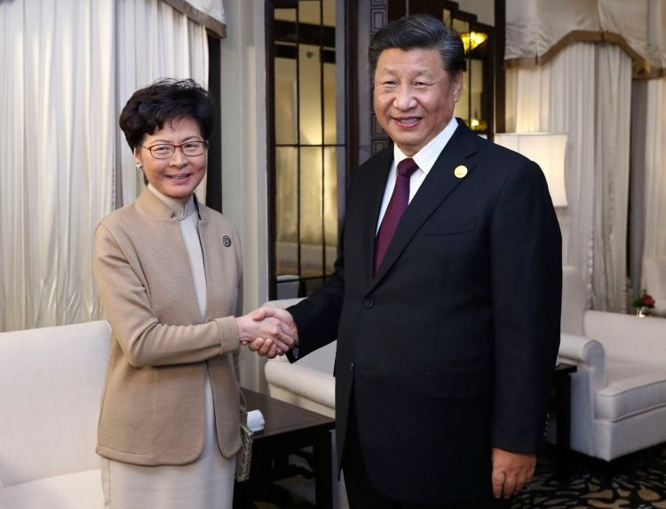 Chinese President Xi Jinping poses with Hong Kong Chief Executive Carrie Lam during a meeting Monday in Shanghai. (Ju Peng/Xinhua News Agency/AP/The Washington Post)