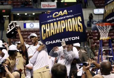 College of Charleston players celebrate after winning the CAA title in  March. (Mic Smith AP) 16a880cd2