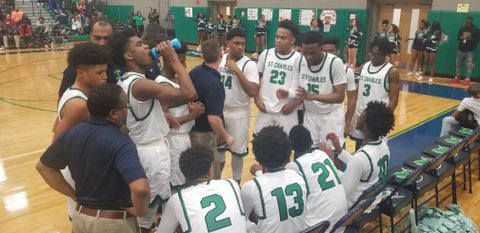 PWT5CKQWDII6TNVNTT6WFW5QVA - Darius Miles excites again in St. Charles's 71-64 win over North Point