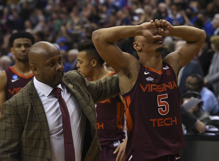 Image result for PICTURE OF A COLLEGE BASKETBALL PLAYER WALKING OFF THE FLOOR IN DISAPPOINTMENT