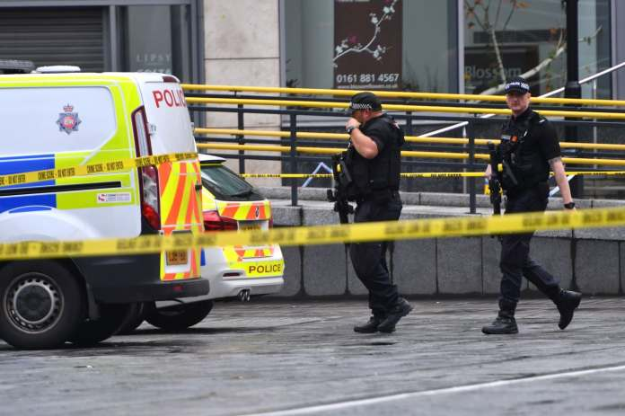Armed police surround the Arndale shopping center, where a man stabbed five people on Oct. 11, 2019, in Manchester, England. (Anthony Devlin/Getty Images)