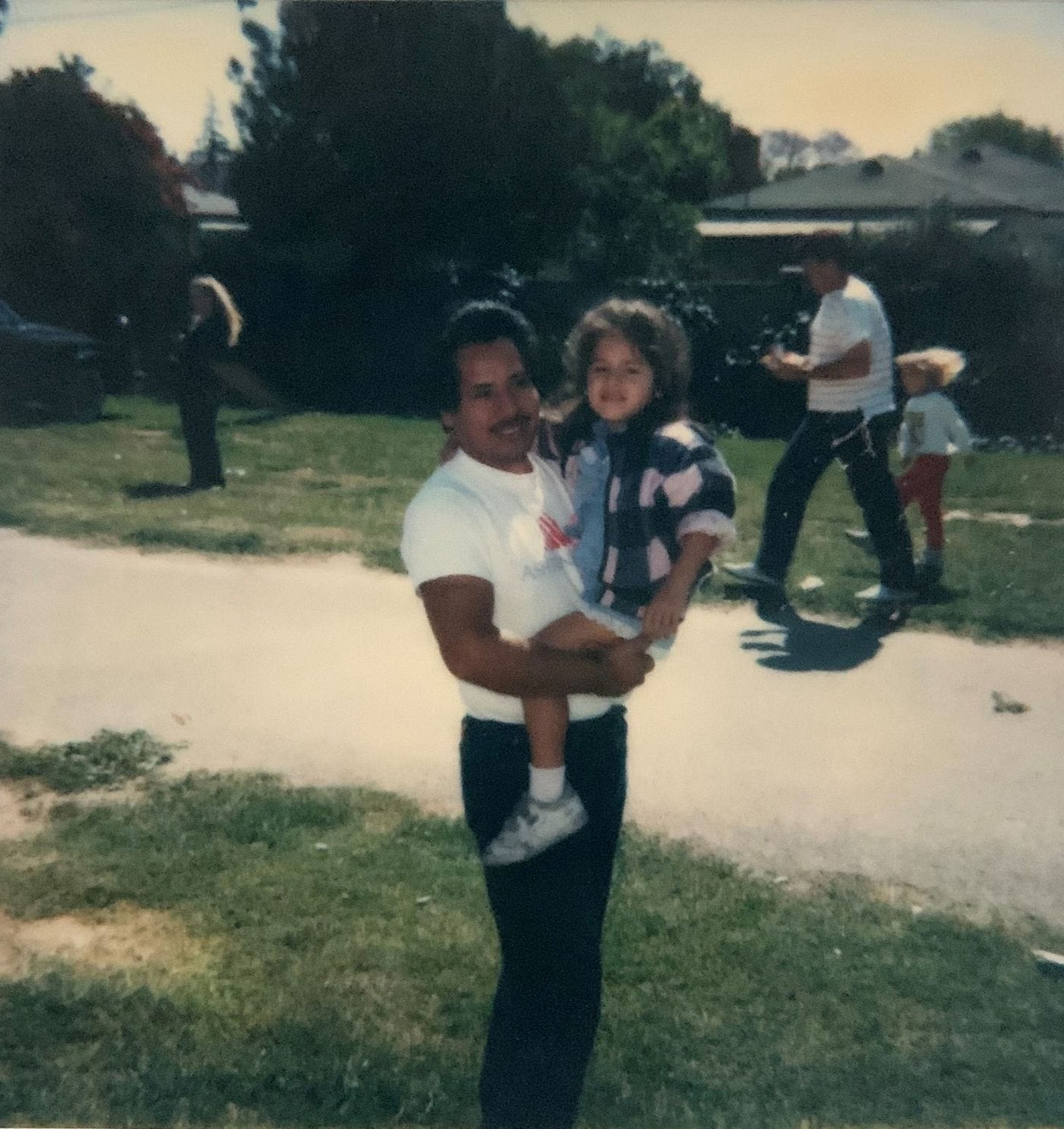 Tina Vasquez and her father in Downey, Calif., in 1990. (Family photo)