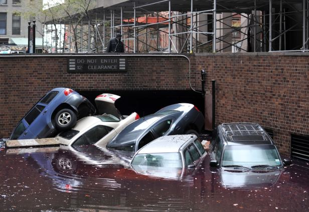 Cars piled on top of each other in a garage in Lower Manhattan on Oct. 31, 2012, after Hurricane Sandy. (STAN HONDA/AFP/Getty Images)