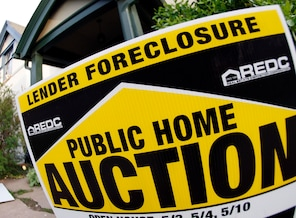 Thousands of foreclosures are put on hold:During the housing boom, millions of homeowners got easy access to mortgages. Now, some mortgage lenders and government officials have taken action after discovering that many mortgage documents were mishandled.