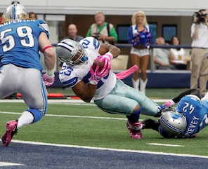 Tashard Choice, then a running back with the Dallas Cowboys, is stopped short of the goal line by Detroit Lions strong safety Amari Spievey Oct. 2. (AP Photo/LM Otero)
