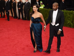 Kanye West (R) and Kim Kardashian (L) arrive at the Costume Institute Benefit at The Metropolitan Museum of Art May 5, 2014 in New York. AFP PHOTO/Timothy A. CLARYTIMOTHY A. CLARY/AFP/Getty Images