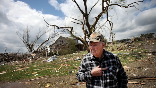 Walter Hayden, 85, looks over the devastation outside his house in Glade Spring, Va.