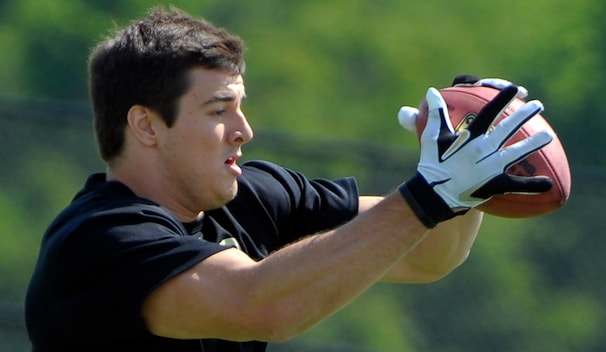 Rookie Ryan Kerrigan, a No. 16 pick out of Purdue, is learning a new position with the help of his new teammates on the Redskins.