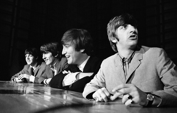 The Beatles, from left, Paul McCartney, George Harrison, John Lennon and Ringo Starr are seen during their first tour of the U.S. (Mike Mitchell/Christie's - Reuters)