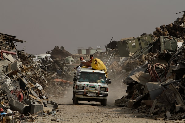 A vehicle leaves a scrap yard in Parwan, Afghanistan. During the past six months, the U.S. forces drawdown has reached a fever pitch in eastern Afghanistan, with dozens of bases being closed, creating a torrent of scrap.