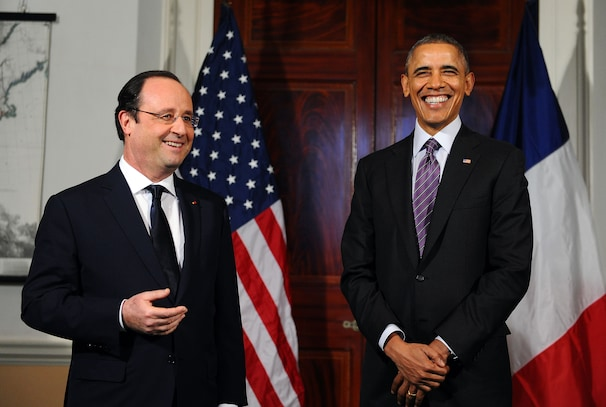 President Obama (R) laughs as his French counterpart Francois Hollande makes a statement to the media following their tour Monticello. JEWEL SAMAD/AFP/Getty Images