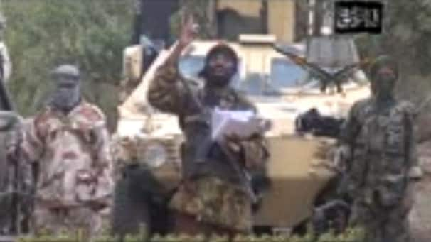 A grab made on May 5, 2014 from a video obtained by AFP shows the leader of the Islamist extremist group Boko Haram Abubakar Shekau (C) delivering a speech. Shekau vowed to sell hundreds of schoolgirls kidnapped in northern Nigeria three weeks ago, in a new video obtained on May 5 by AFP.