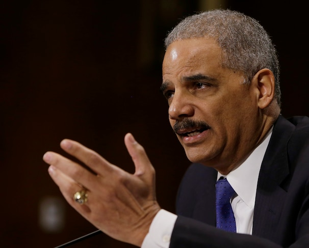 United States Attorney General Eric Holder testifies before the Senate Judiciary Committee hearing on oversight of the Justice Department and the reform of government surveillance programs, in Washington in this January 29, 2014 file photo. Holder on May 19, 2014 announced the indictments of five Chinese nationals on cyber espionage charges for allegedly stealing trade secrets from American companies. Picture taken January 29, 2014.REUTERS/Gary Cameron/Files  (UNITED STATES - Tags: POLITICS CRIME LAW SCIENCE TECHNOLOGY)