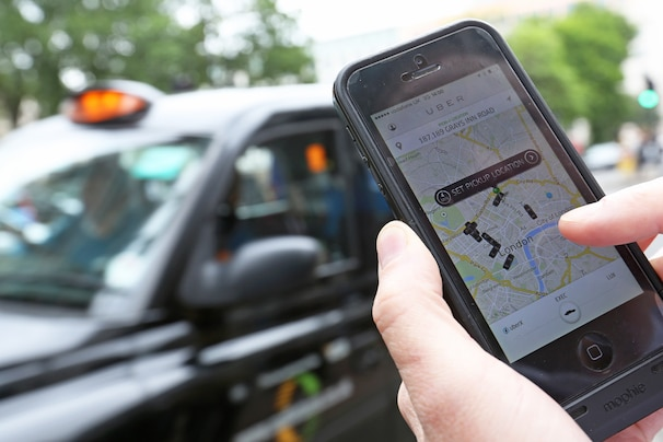 A user scans for an available vehicle using Uber Technologies's app on a smartphone  in London. (Photo illustration: Chris Ratcliffe/Bloomberg News)