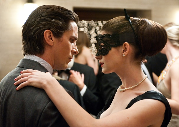 Selina Kyle and Bruce Wayne (Anne Hathaway and Christian Bale) in The Dark Knight Rises