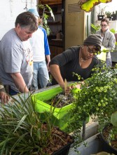 Groce helps student mix soil