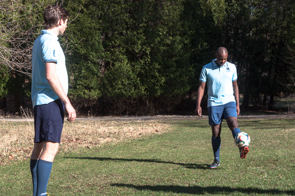 Konx Cameron practices soccer with team mate