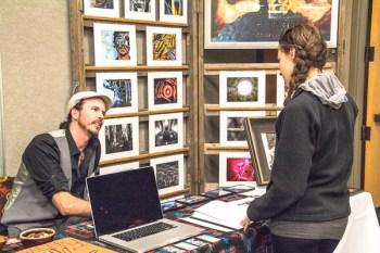 photographer Benjamin Bear talks with young lady