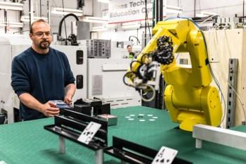 Aaron Rowe working robotic blackjack-dealing machine