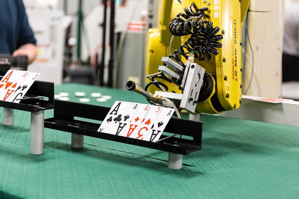 automated blackjack-dealing machine deals cards