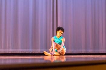 dancer sitting on stage