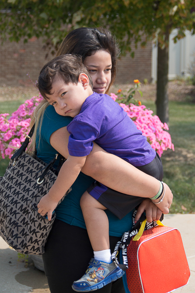 Valarie Cabrera holds her child in her arms