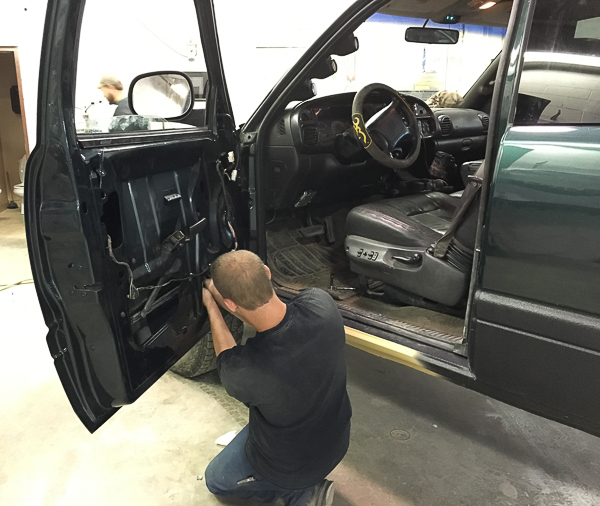 WCC alumnus working on an automobile