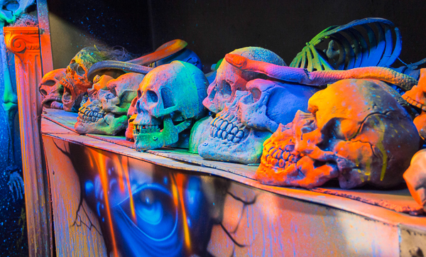A shelf of skulls and other creepy props