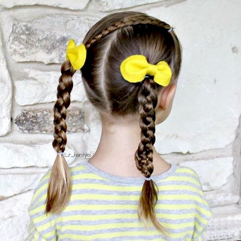Braid hairstyles with two yellow ribbons