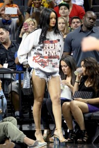 Casual clothes rihanna with white sweater and high heels