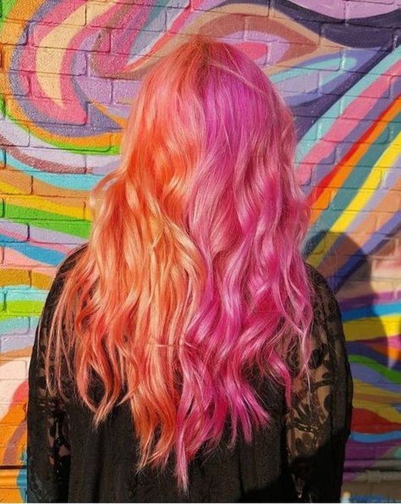 Long hairstyles with wavy orange and pink hair color