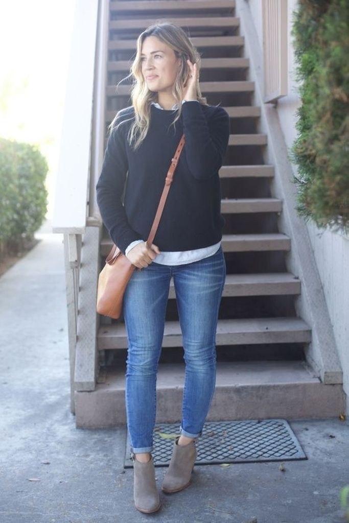 Spring outfit with black sweater and brown bag