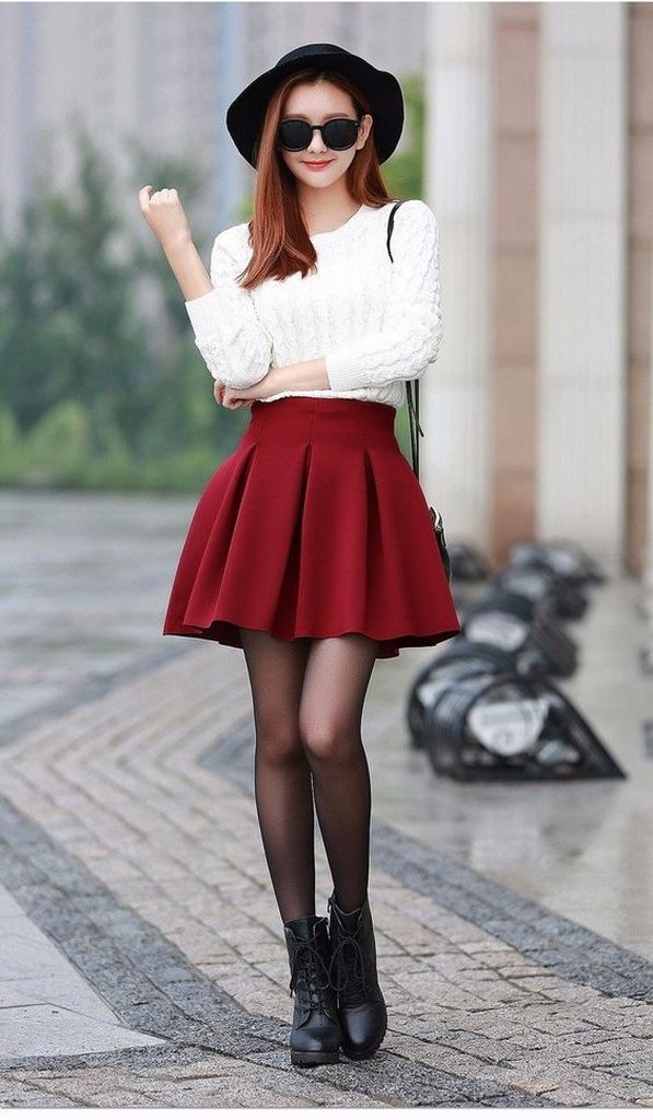 Spring outfit with white white sweater and little flared red skirt