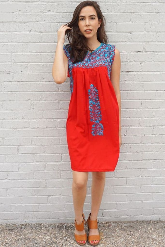 Red dress with embroidered intricate blue flowers
