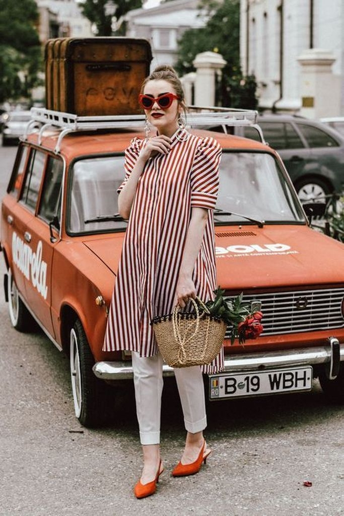 Striped dresses with white over trousers