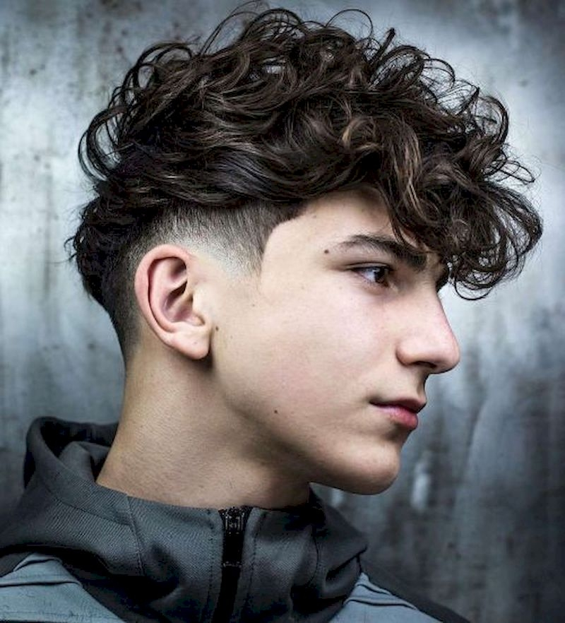 Haircuts for men with hair cut short on sides and kept wavy long on top