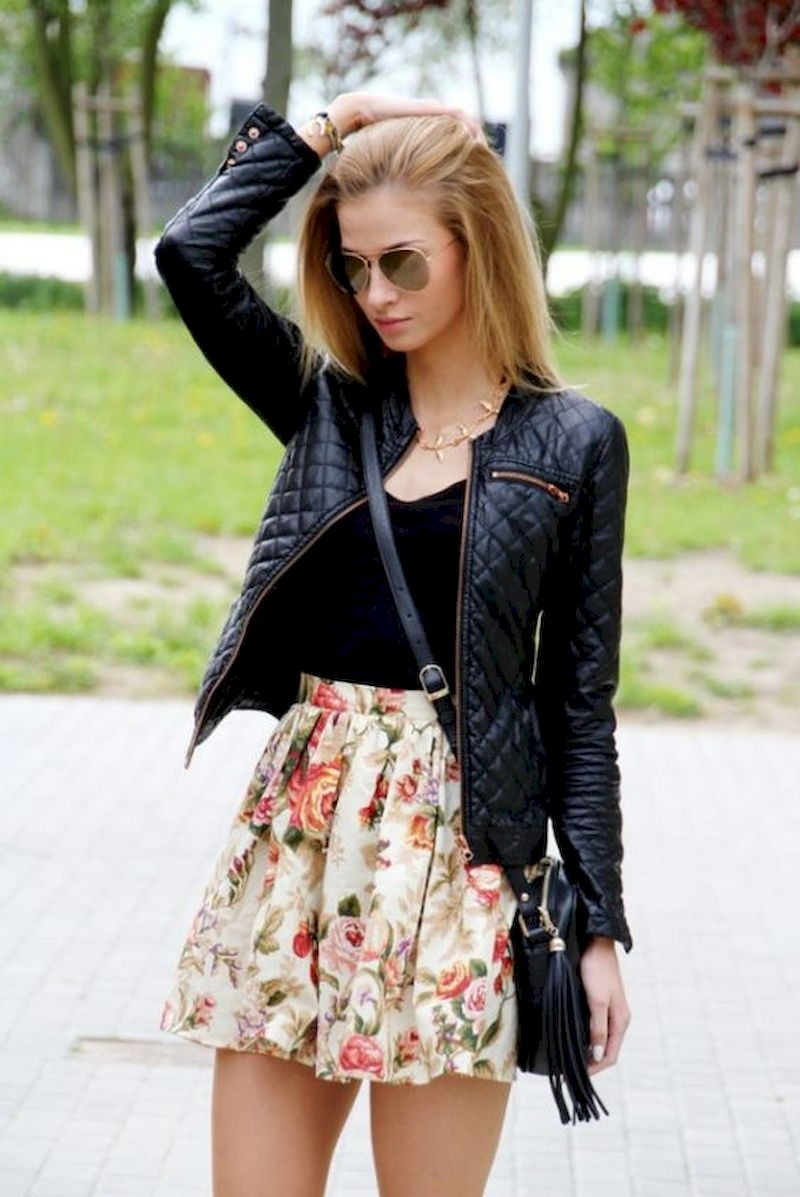 Spring outfit inspiration with short floral skirt and black jacket