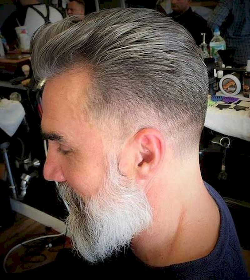 Hairstyles for bald men with hair combed back and thin sides