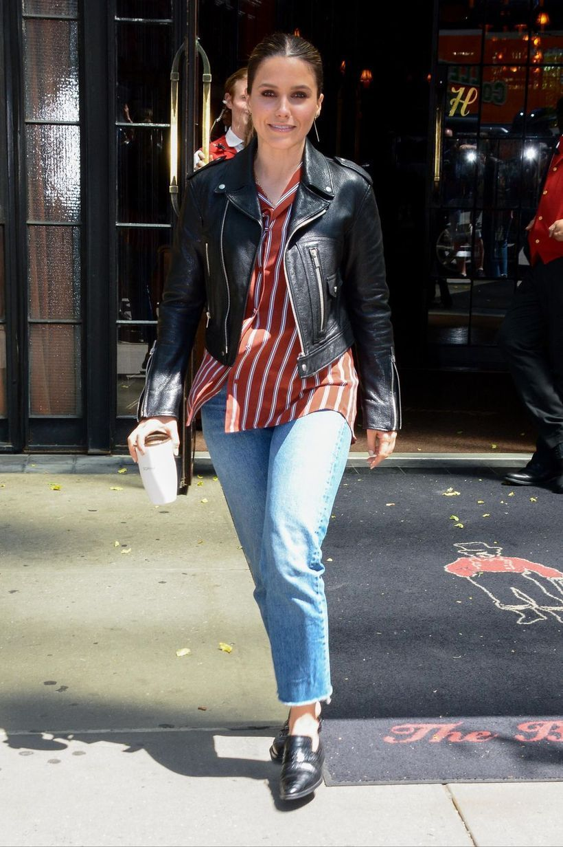 Black leather jacket with red stripeed shirt, denim pants and black shoes