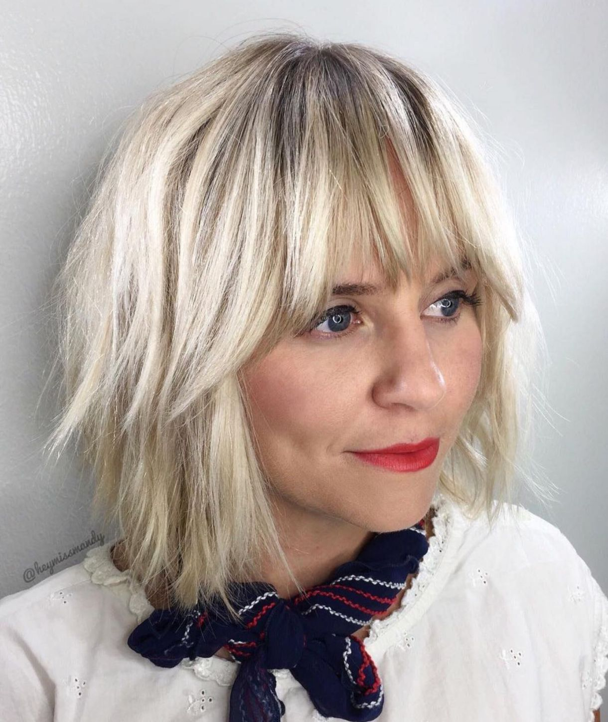 Blonde fringes with feathered chop