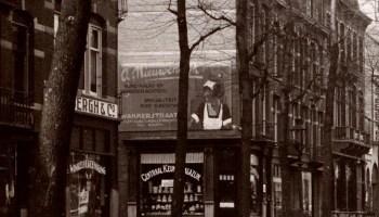 Muurschildering in de Wakkerstraat, gezien vanaf de Middenweg voor Rund-, kalfs- en varkensslachterij Anton Nieuwendijk