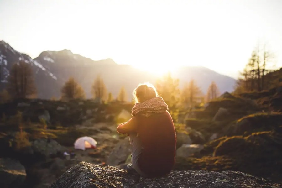 A woman sitting in the sun in Scotland