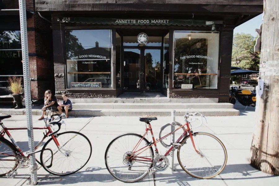 Bicycle in front of a coffee shop in the Junction neighbourhood in Toronto