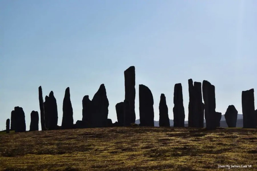 The Callanish Standing Stones are one of Scotland's most iconic landmarks on the Outer Hebrides and turn the Isle of Lewis into a great road trip destination!