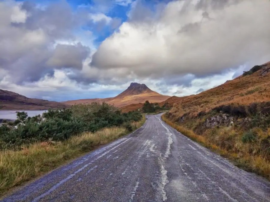 The recognisable peak of Stac Pollaidh in the northwest of Scotland lies along a scenic drive around the Coigach peninsula.