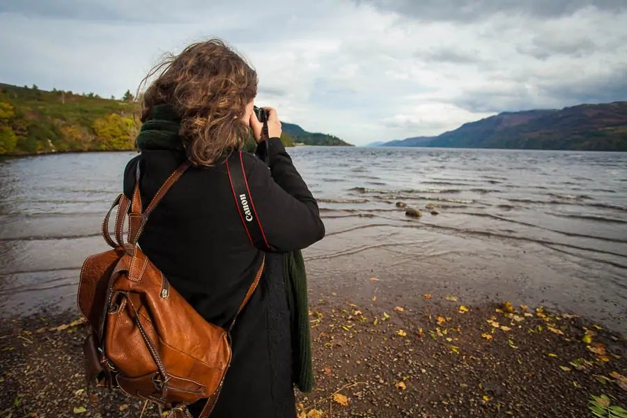 A woman taking photos of Loch Ness.